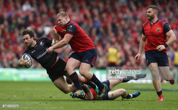 Marcelo Bosch of Saracens is tackled by Keith Earls and John Ryan during the European Rugby Champions Cup semi final match between Munster and...