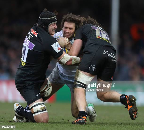 Marcelo Bosch of Saracens is tackled by Mitch Lees and Alec Hepburn during the Aviva Premiership match between Exeter Chiefs and Saracens at Sandy...