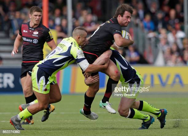 Marcelo Bosch of Saracens tackled by Tom Curry and Mark Jennings of Sale Sharks during the Aviva Premiership match between Saracens and Sale Sharks...