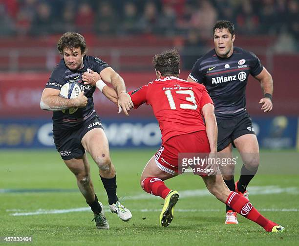 Marcelo Bosch of Saracens takes on Andrew Smith during the European Rugby Champions Cup match between Munster and Saracens at Thomond Park on October...