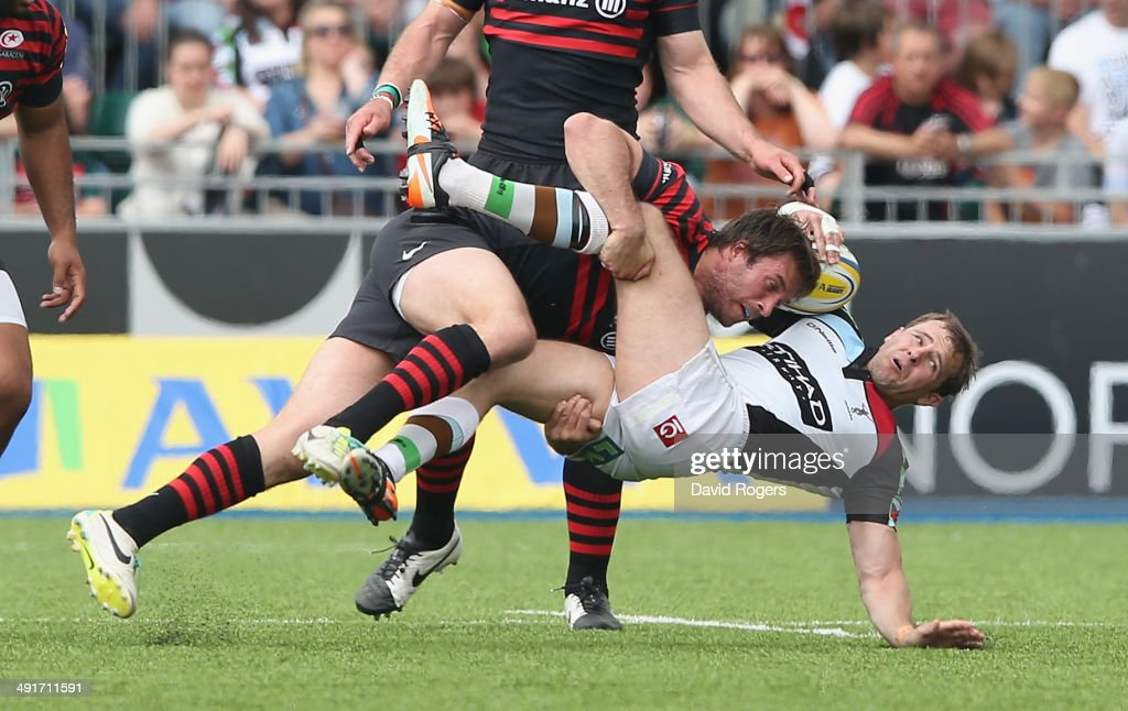 Marcelo Bosch of Saracens takes out Nick Evans which led to him being sin binned during the Aviva Premiership semi final match between Saracens and Harlequins at Allianz Park on May 17, 2014 in Barnet, England.