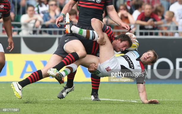 Marcelo Bosch of Saracens takes out Nick Evans which led to him being sin binned during the Aviva Premiership semi final match between Saracens and...