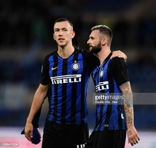 Marcelo Brozovic and Ivan Perisic of FC Internazionale chat during the Serie A match between SS Lazio and FC Internazionale at Stadio Olimpico on...