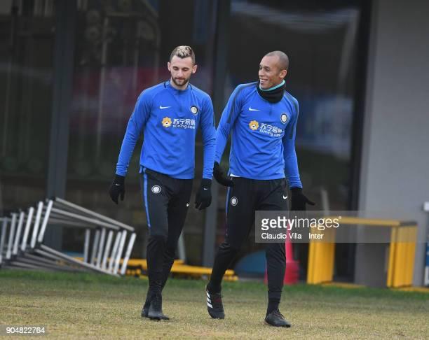 Marcelo Brozovic and Joao Miranda de Souza Filho of FC Internazionale chat during the FC Internazionale training session at Suning Training Center at...