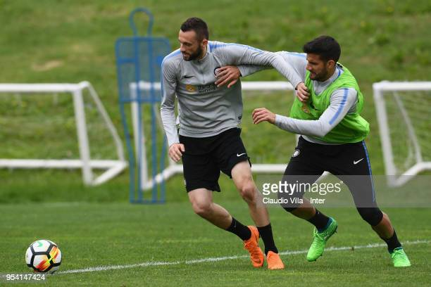 Marcelo Brozovic and Lisandro Lopez of FC Internazionale compete for the ball during the FC Internazionale training session at the club's training...