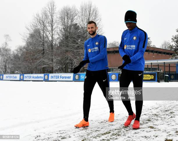 Marcelo Brozovic and Yann Karamoh of FC Internazionale chat during the FC Internazionale training session at the club's training ground Suning...