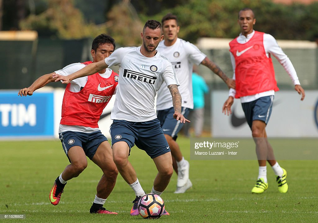 Marcelo Brozovic (R) is challenged by Yuto Nagatomo (L) during the FC Internazionale training session at the club's training ground 'La Pinetina' on September 30, 2016 in Como, Italy.