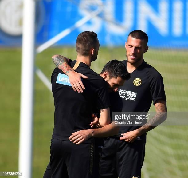 Marcelo Brozovic Matteo Politano and Cristiano Biraghi of FC Internazionale react during FC Internazionale training session at Appiano Gentile on...