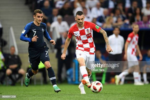 Marcelo Brozovic of Croatia and Antoine Griezmann of France compete for the ball during the 2018 FIFA World Cup Russia Final between France and...