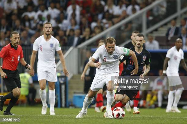 Marcelo Brozovic of Croatia and Harry Kane of England vie for the ball during the 2018 FIFA World Cup Russia semi final match between Croatia and...