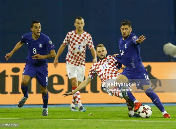 Marcelo Brozovic of Croatia in action against Zeca and Tasos Bakasetas of Greece during the FIFA 2018 World Cup Qualifier PlayOff First Leg between...
