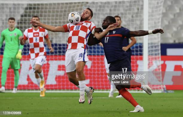 Marcelo Brozovic of Croatia in action with Moussa Sissoko of France during the UEFA Nations League group stage match between France and Croatia at...