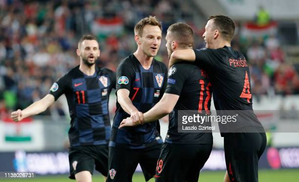 Marcelo Brozovic of Croatia, Ivan Rakitic of Croatia, Ante Rebic of Croatia and Ivan Perisic of Croatia celebrate during the 2020 UEFA European...