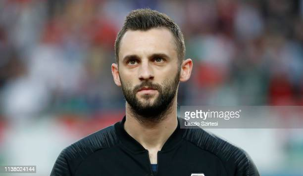 Marcelo Brozovic of Croatia listens to the anthem prior to the 2020 UEFA European Championships group E qualifying match between Hungary and Croatia...