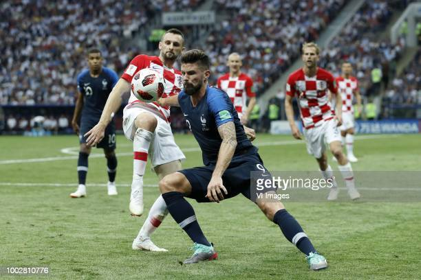 Marcelo Brozovic of Croatia, Olivier Giroud of France during the 2018 FIFA World Cup Russia Final match between France and Croatia at the Luzhniki...