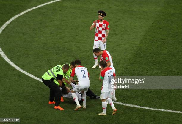 Marcelo Brozovic of Croatia puts on the hat of a pitch invader during the 2018 FIFA World Cup Russia Final between France and Croatia at Luzhniki...