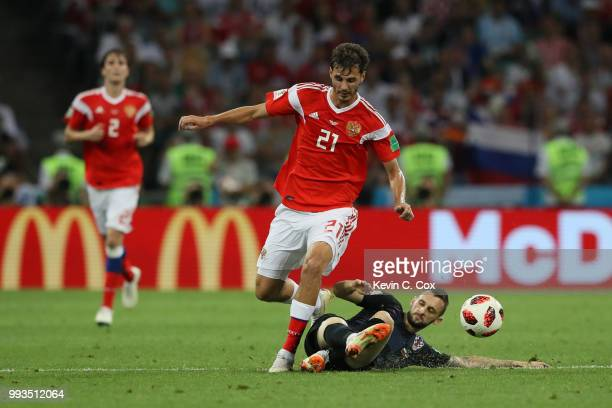 Marcelo Brozovic of Croatia tackles Aleksandr Erokhin of Russia during the 2018 FIFA World Cup Russia Quarter Final match between Russia and Croatia...