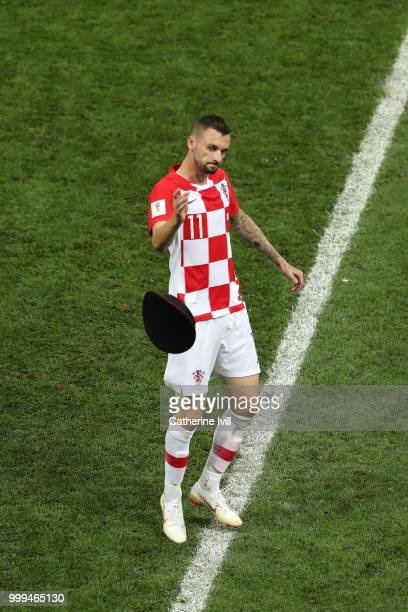 Marcelo Brozovic of Croatia throws a pitch invaders hat off the pitch during the 2018 FIFA World Cup Final between France and Croatia at Luzhniki...