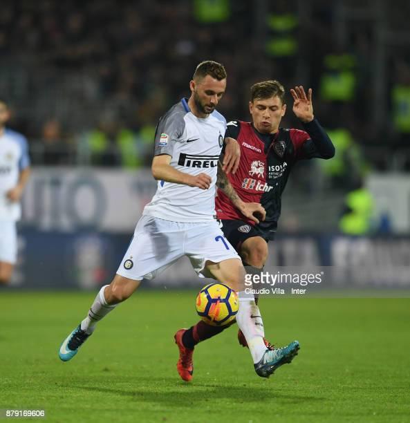 Marcelo Brozovic of FC Internazionale and Nicolò Barella of Cagliari Calcio compete for the ball during the Serie A match between Cagliari Calcio and...
