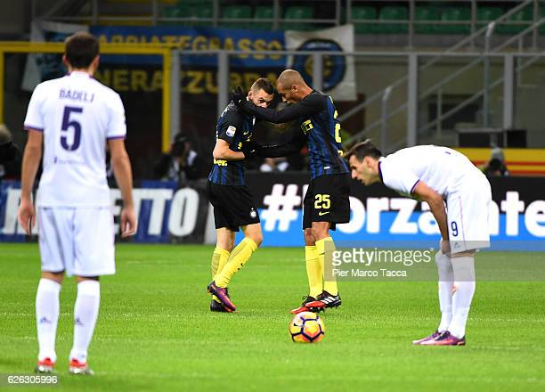 Marcelo Brozovic of FC Internazionale celebrates his first goal with Joao Miranda during the Serie A match between FC Internazionale and ACF...