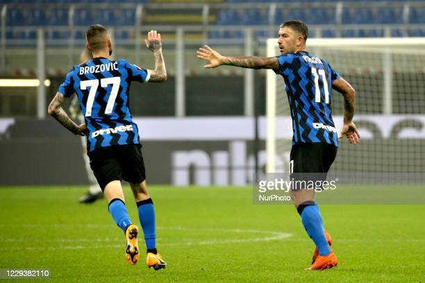 Marcelo Brozovic of FC Internazionale celebrates with Aleksandar Kolarov of FC Internazionale after scoring the goal during the Serie A match between...