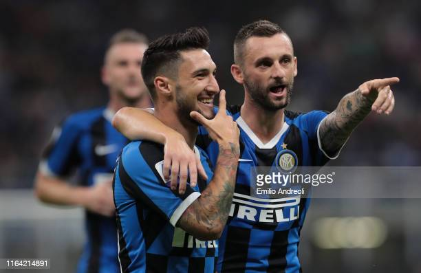 Marcelo Brozovic of FC Internazionale celebrates with his teammate Matteo Politano during the Serie A match between FC Internazionale and US Lecce at...