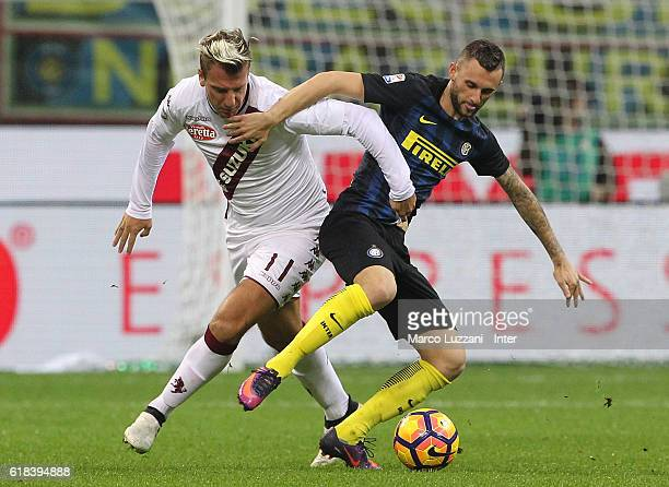 Marcelo Brozovic of FC Internazionale competes for the ball with Maxi Lopez of FC Torinol during the Serie A match between FC Internazionale and FC...