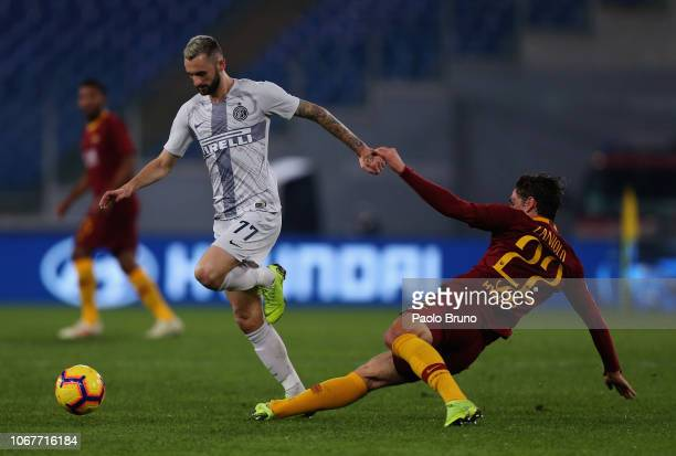 Marcelo Brozovic of FC Internazionale competes for the ball with Nicolo' Zaniolo of AS Roma during the Serie A match between AS Roma and FC...