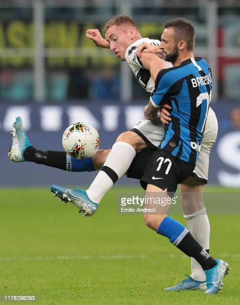 Marcelo Brozovic of FC Internazionale competes for the ball with Dejan Kulusevski of Parma Calcio during the Serie A match between FC Internazionale...