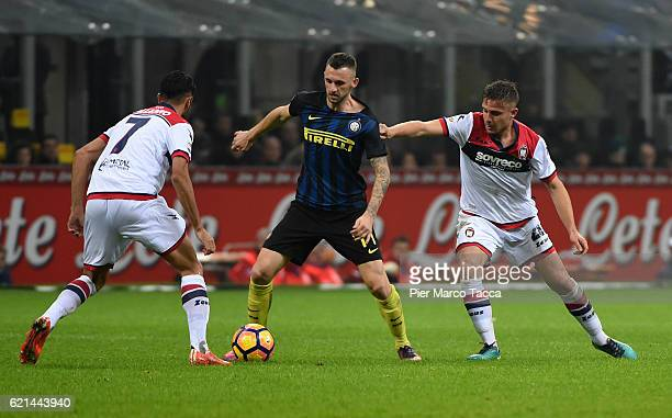 Marcelo Brozovic of FC Internazionale competes for the ball with Leonardo Capezzi of FC Crotone during the Serie A match between FC Internazionale...