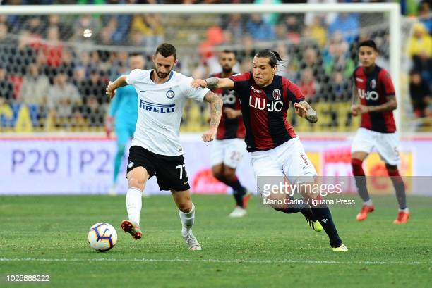 Marcelo Brozovic of FC Internazionale competes the ball with Federico Santander of Bologna FC during the serie A match between Bologna FC and FC...
