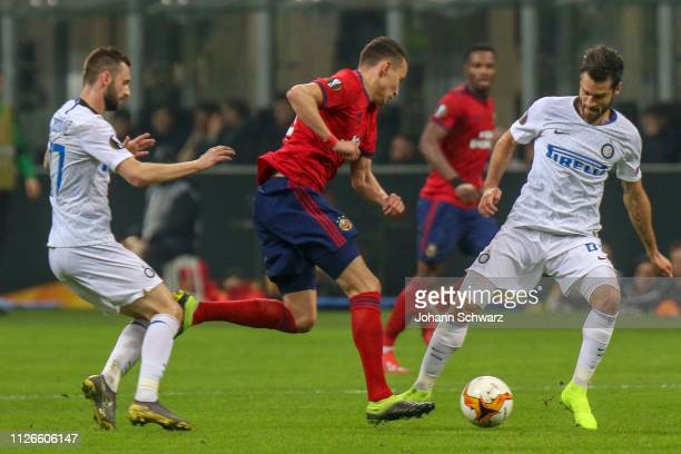 Marcelo Brozovic of FC Internazionale Dejan Ljubicic of Rapid and Milan Skriniar of FC Internazionale during the UEFA Europa League Round of 32 match...