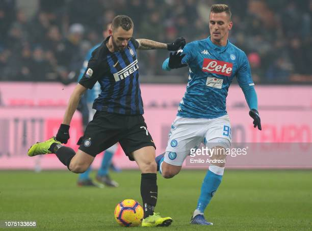 Marcelo Brozovic of FC Internazionale is challenged by Arkadiusz Milik of SSC Napoli during the Serie A match between FC Internazionale and SSC...