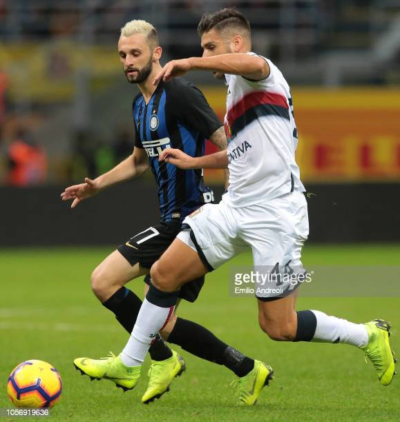 Marcelo Brozovic of FC Internazionale is challenged by Miguel Veloso of Genoa CFC during the Serie A match between FC Internazionale and Genoa CFC at...