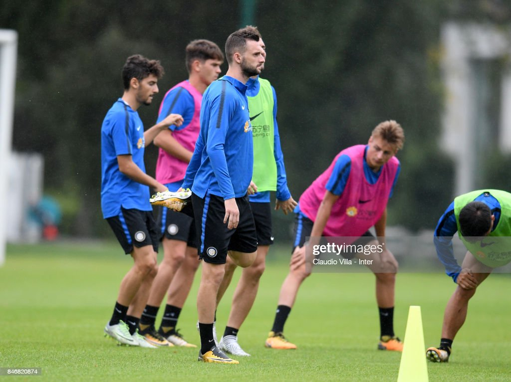 Marcelo Brozovic of FC Internazionale (C) looks on during a training session at Suning Training Center at Appiano Gentile on September 14, 2017 in Como, Italy.
