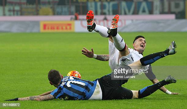 Marcelo Brozovic of FC Internazionale Milano clashes with Fabio Pisacane of Cagliari Calcio during the TIM Cup match between FC Internazionale Milano...