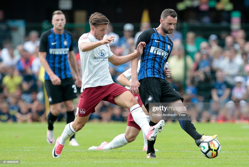 Marcelo Brozovic of FC Internazionale Milano (R) competes for the ball with Patrick Kammerbauer of FC Nurnberg during the Pre-Season Friendly match between FC Internazionale and Nurnberg on July 15, 2017 in Bruneck, Italy.