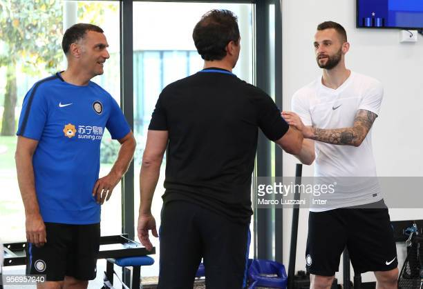 Marcelo Brozovic of FC Internazionale shakes hands with Riccardo Ferri and Giuseppe Bergomi of Inter Forever during the FC Internazionale training...