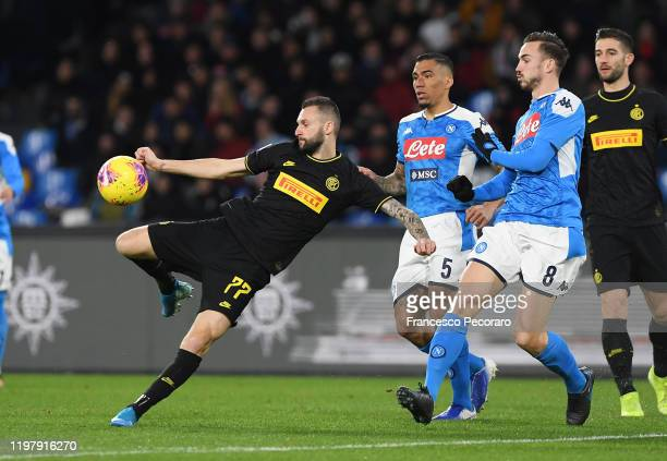 Marcelo Brozovic of FC Internazionale vies with Fabian Ruiz of SSC Napoli during the Serie A match between SSC Napoli and FC Internazionale at Stadio...