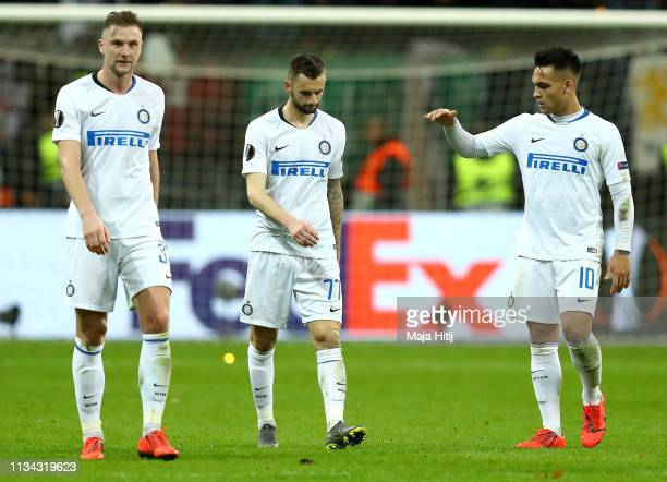 Marcelo Brozovic of FC Internazionale walks off dejected after the UEFA Europa League Round of 16 First Leg match between Eintracht Frankfurt and FC...