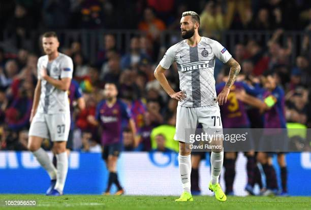 Marcelo Brozovic of Inter Milan looks dejected after Barcelona scores their first goal during the Group B match of the UEFA Champions League between...