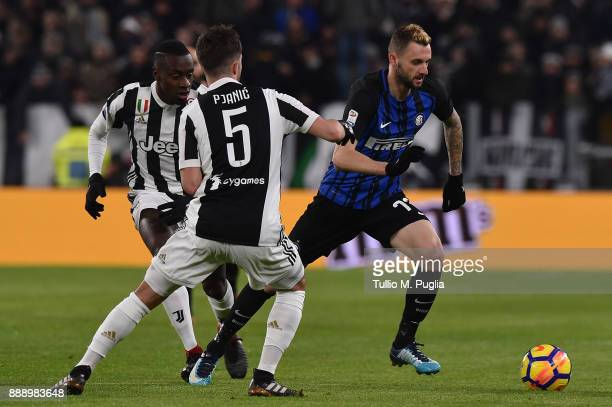 Marcelo Brozovic of Internazionale holds off the challange from Blaize Matuidi and Miralerm Pjanic of Juventus during the Serie A match between...