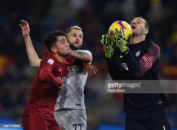 Marcelo Brozovic with his goalkeeper Samir Handanovic of FC Internazionale competes for the ball with Gengiz Under of AS Roma during the Serie A...