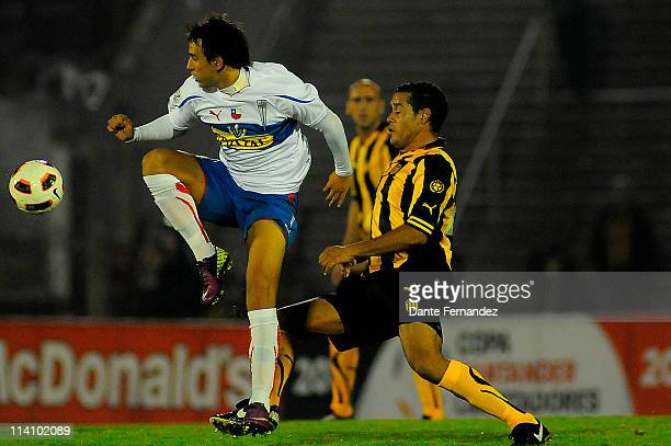 Marcelo Canete of Universidad Catolica jumps for the ball during a match as part of the Santander Libertadores Cup 2011 at the Centenary Stadium on...