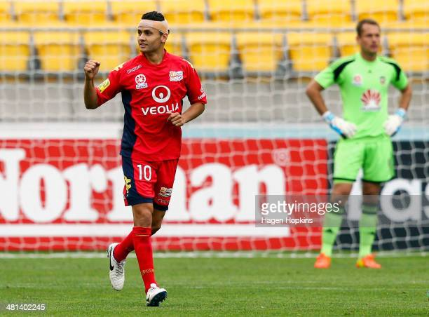 Marcelo Carrusca of Adelaide United celebrates after scoring a goal while Glen Moss of the Phoenix looks on during the round 25 ALeague match between...