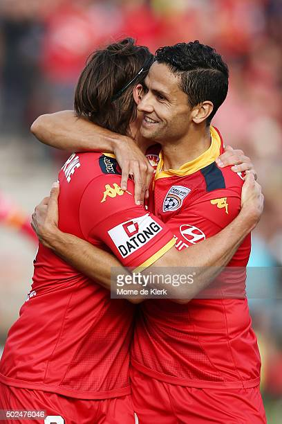 Marcelo Carrusca of Adelaide United congratulates teammate Michael Marrone after he scored a goal during the round 12 ALeague match between Adelaide...