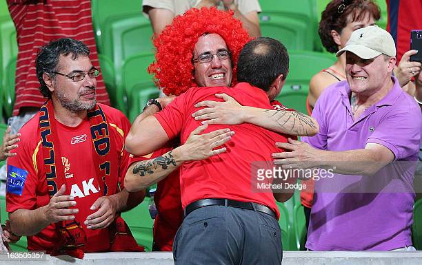 Marcelo Carrusca of Adelaide United gets a hug from a fan during the round 24 ALeague match between the Melbourne Heart and Adelaide United at AAMI...