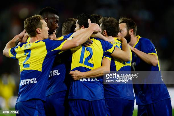 Marcelo Carrusca of the All Stars celebrates with team mates after scoring the first goal during the match between the ALeague All Stars and Juventus...