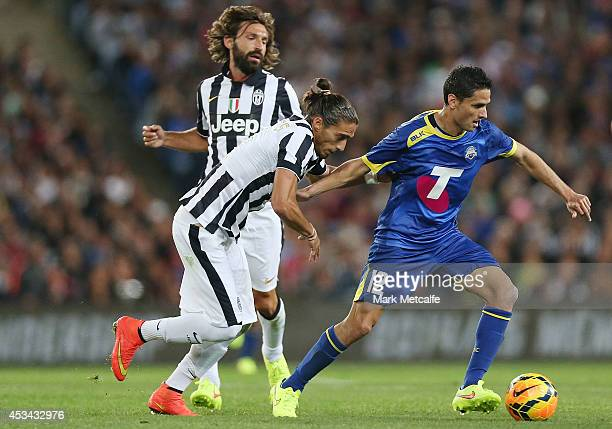 Marcelo Carrusca of the All Stars is challenged by Martin Caceres of Juventus during the match between the ALeague All Stars and Juventus at ANZ...