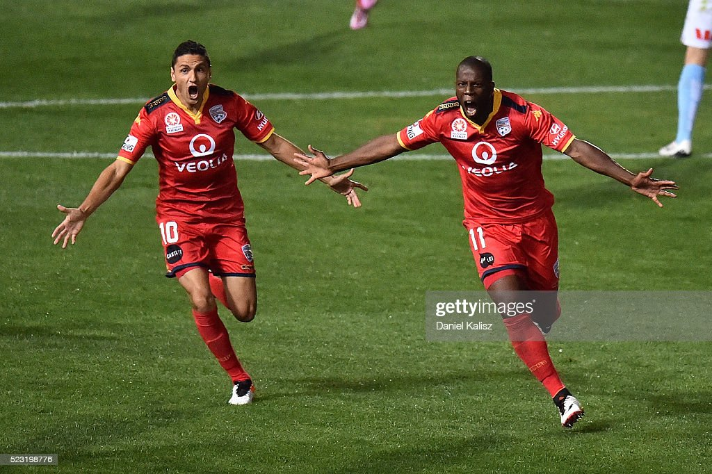 Marcelo Carrusca of United and Bruce Djite of United react after scoring a goal during the A-League Semi Final match between Adelaide United and Melbourne City at Coopers Stadium on April 22, 2016 in Adelaide, Australia.